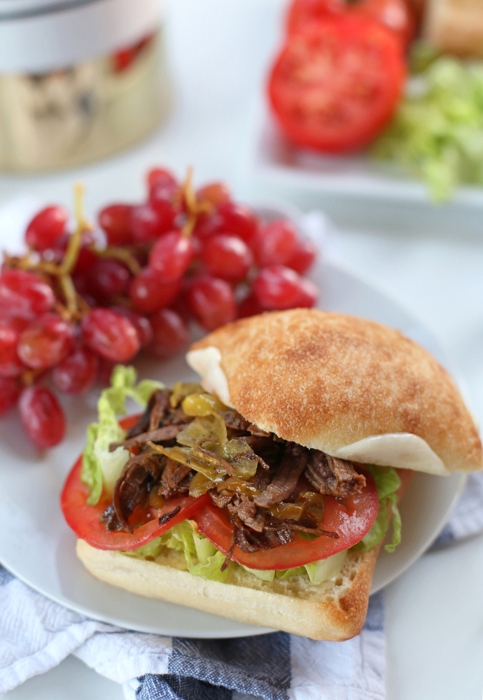 A super easy crockpot recipe for shredded beef sandwiches that the whole family will love