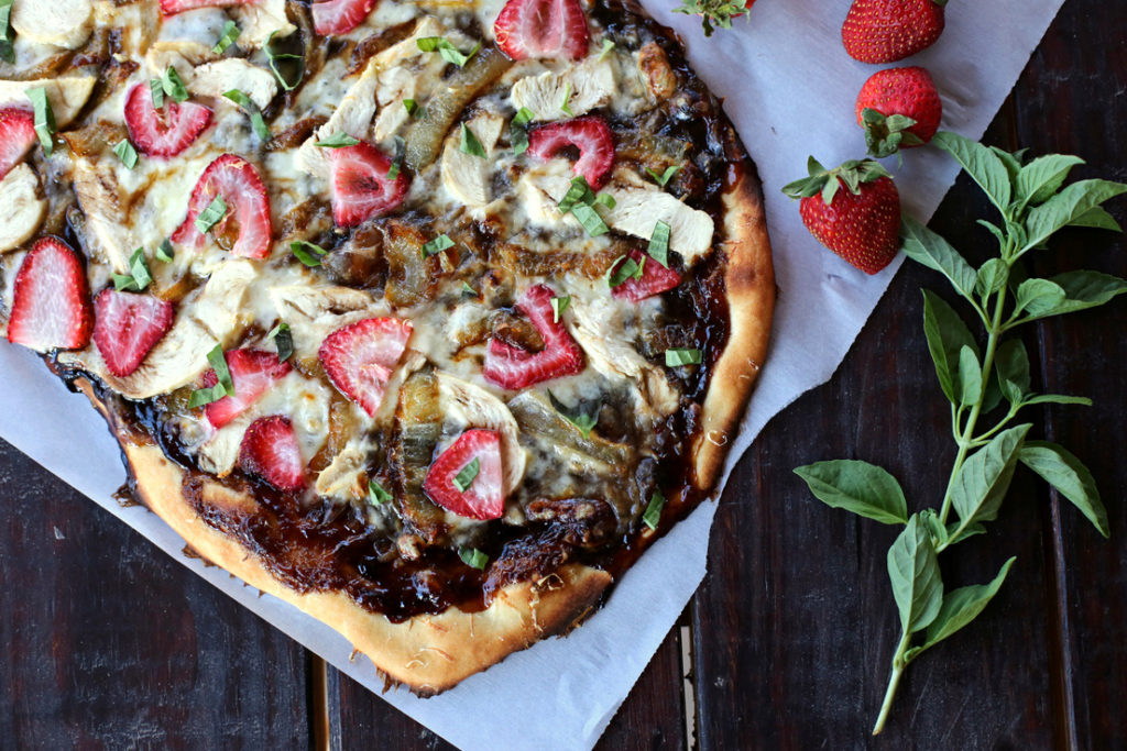 A delicious summer-y spin on pizza night with strawberries, a balsamic reduction, and fresh basil
