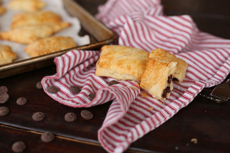 Super easy and delicious little hand pies stuffed with chocolate chips and cream cheese. These are a perfect little treat to make with the kids!