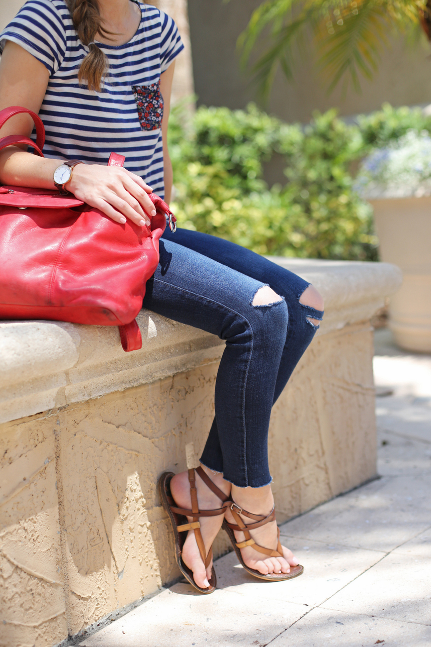 stripes + distressed denim + red bag