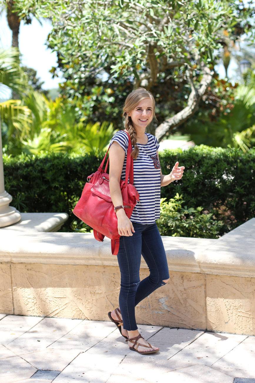stripes + distressed denim + red bag