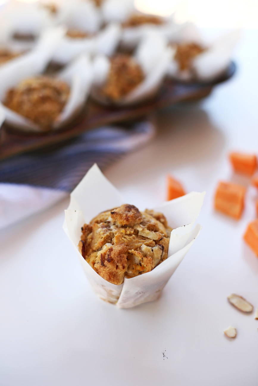 These delicious sweet potato muffins have a warm orange flavor, a crunchy cinnamon almond topping, and a hint of fall spice.