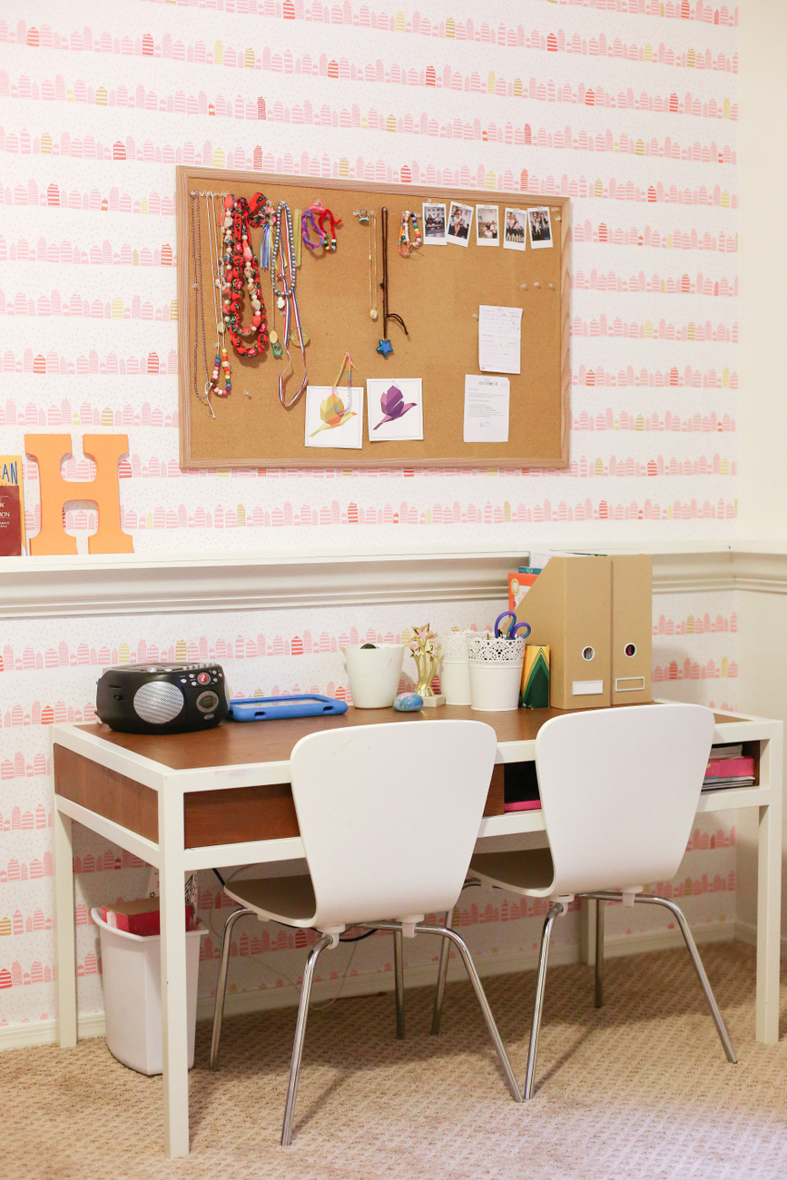 A little girl room with wallpaper from Spoonflower with a modern and fun whimsical pink and gold print that makes a room feel special